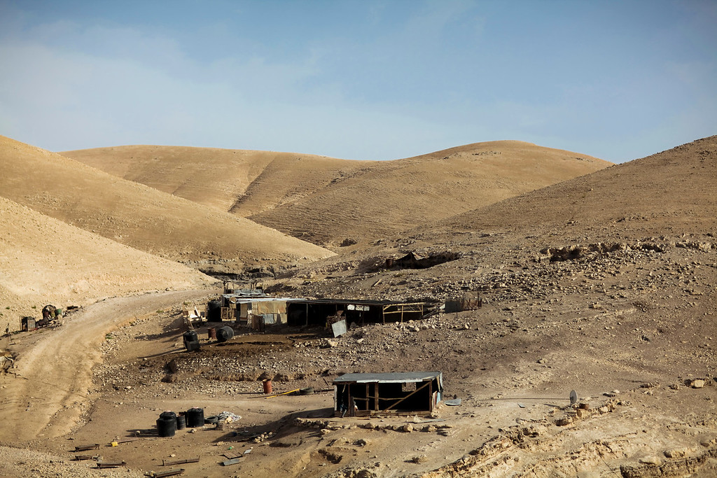 Bedouin camp.  The Bedouins are technically nomads but they have hunkered down to such a degree that Israel is running sewer and water to them.