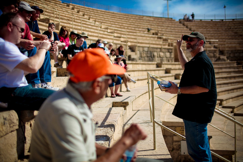 Teaching at Caesarea.  The vomitorium is just inside those doorways.  Are we far really all that different today?