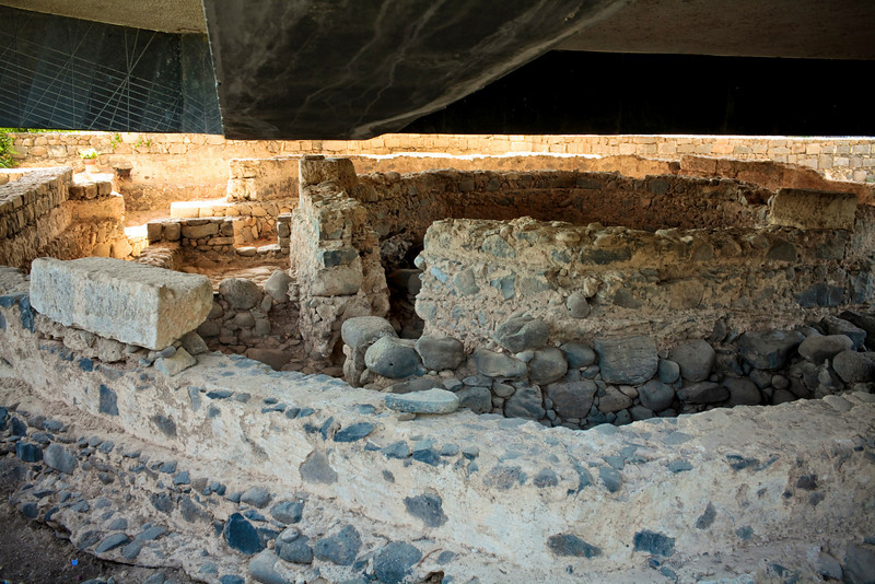 Peter's house (probably).  They found all kinds of fishing artifacts in this home here in Capernaum.  The beams overhead are the bottom of the Catholic spaceship.