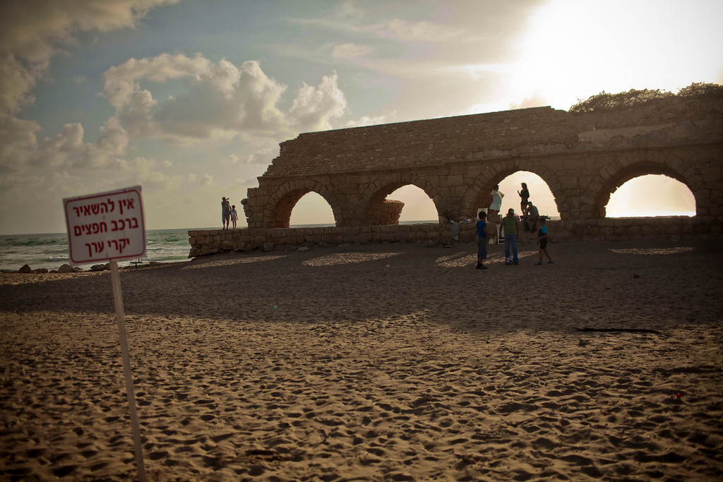 "A 10mile long aqueduct that brought water to Caesarea.  Now it is enjoyed by families for picnics on the beach.  The sign on the left is from ancient Roman times.  It says, ""No Toga, no service""."