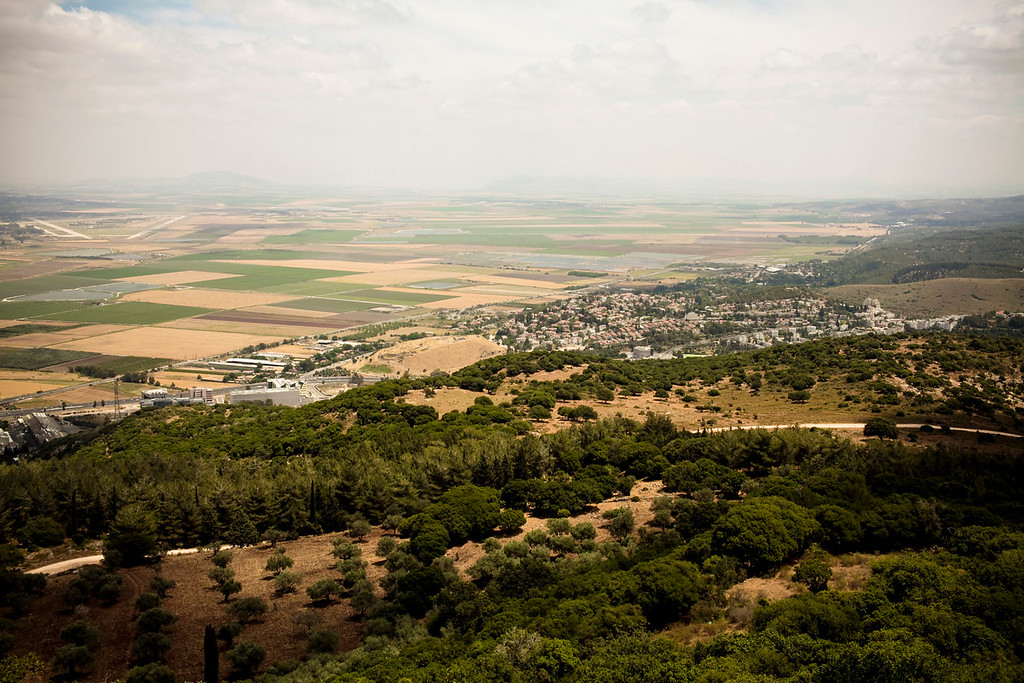 The valley of Meggido (where the battle of Armeggedon will take place) seen from Mt. Carmel where Elijah exposed the prophets of Baal as fakes.  Far in the distance on the left is a strategic military airstrip.  The jets are kept underground.