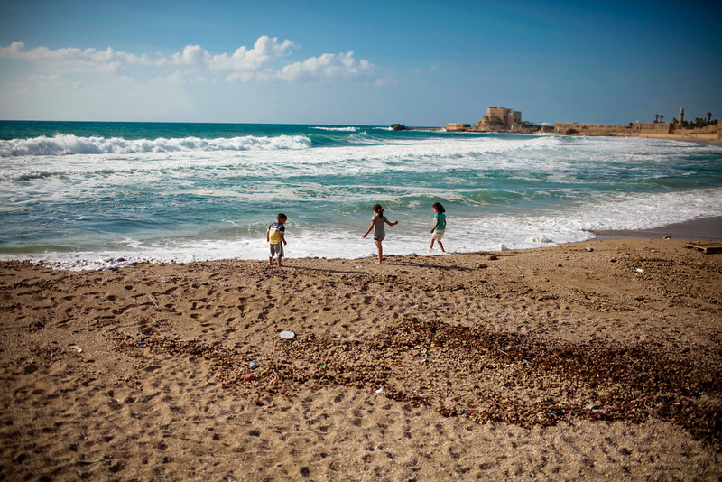 Some children enjoying the water at Caesarea.