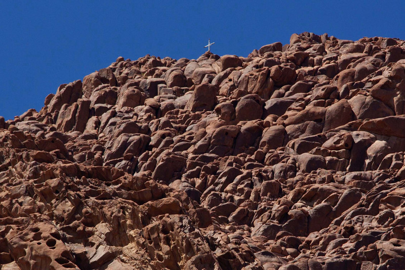 Extreme telephoto shot of the top of Mt. Sinai, 7,400'. The cross was put at the summit by St. Katherine monks to warn Egyptian fighter pilots that the buildings below (St. Katherine's Monastery) were not to be obliterated. The warning has worked. So far.