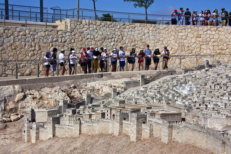 A class looking down at the model of 79 AD Jerusalem.