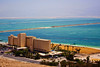 Some luxury hotels with some settling ponds (for harvesting salt and minerals) of the Dead Sea in the background.