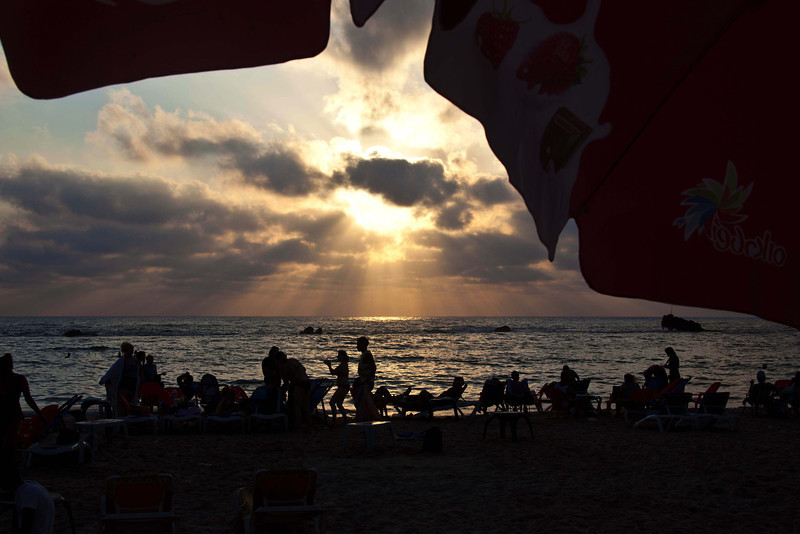 Drinks near the beach before sundown, when the beach REALLY comes to life. Well, then and on the Sabbath, when the beach is chockablock full and the relatively few synagogues of Tel Aviv are empty.