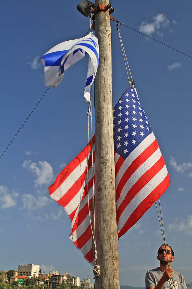Raising American Flag Alongside Flag of Israel
