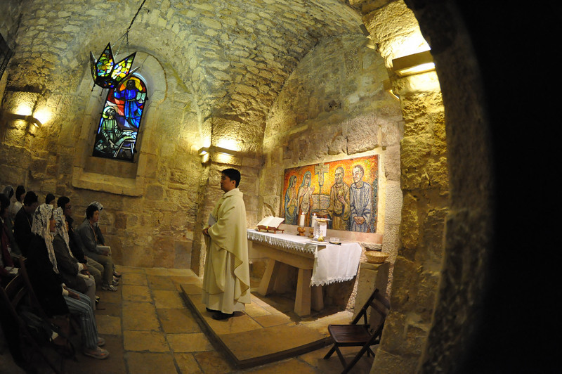 Working place of St. Jerome, below The Church of St. Catherine, Bethlehem, West Bank<br /> Peeking inside  for the Mosaic, some Koreans having mass.