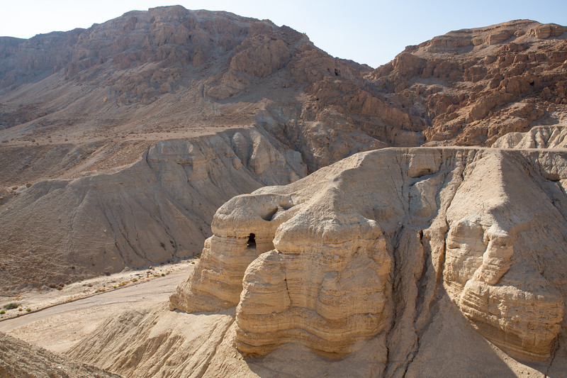 Cave at Qumran - where the Dead Sea scrolls were found (additional caves in the distance)