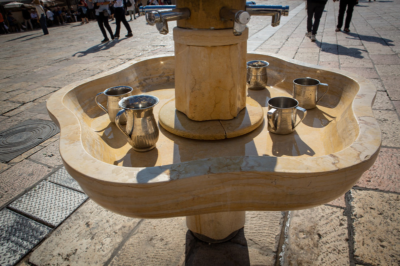 Washing station at the Western Wall - two handled cups for proper hand washing