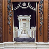 An elaborate cover of a torah scroll, depicting the artist's vision of the old Temple.