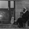 An observant Jew pauses his music to recite the evening and the Chanuka prayers.