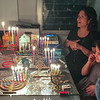 Lymore and Sami singing traditional Chanuka songs after lighting candles.