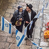 A young couple strolling through the Jewish Quarter of the Old City in Jerusalem.