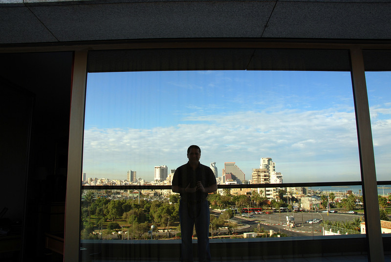 The reflection in my balcony window shows Tel Aviv.