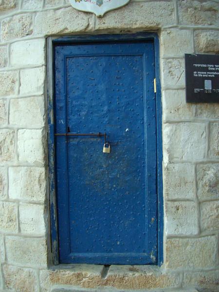 Blue door at base of windmill in Jerusalem.