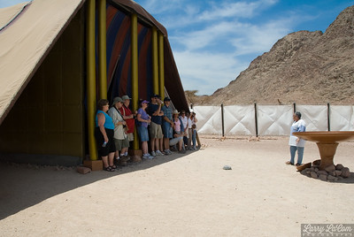 Our guide standing next to the bronze laver, with some of our group assembled in the shade of the tent of meeting.