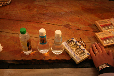 Holy water and other items placed on the stone in the Church of the Holy Sepulcher
