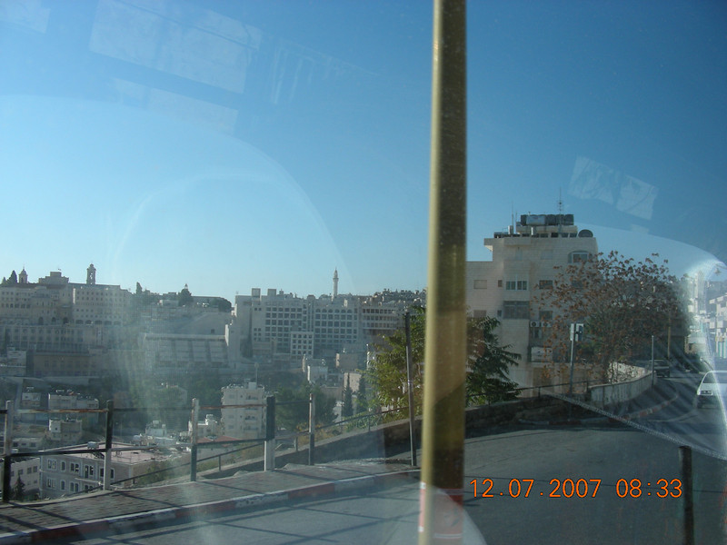 First view of Bethlehem from the bus.  Bethlehem means house of the fertility God.  Began in 142 AD.  Now no Jews left.  The population is Christian and Muslim.