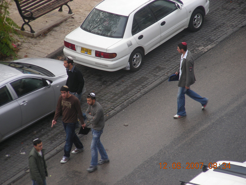 Some young-adult Jewish guys heading out on a Sabbath (Saturday) morning.