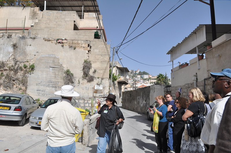 The tour guide explaining how they found Mary's home and Joseph's home.