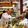 Israel Jerusalem Mahane Yehuda market man selling olive oils and pastas