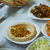Israel Jerusalem restaurant - hummus with chick peas garbanzo beans with pita bread along with fresh salads
