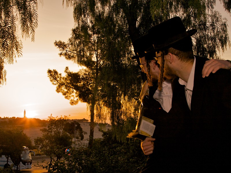 Some orthodox jews who allowed me to take a picture of them watching the sun rise over East Jerusalem.