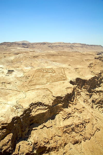That is actually the remains of the old roman camp that perpetuated the sieze on the inhabitants of Masada.