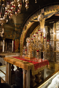 The site of Christ's crucifixion.  Just below the alter is said to have been the base of the cross.