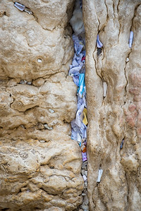 Prayers in the western wall.  Up close you can see the writing on the paper, each telling its own story.