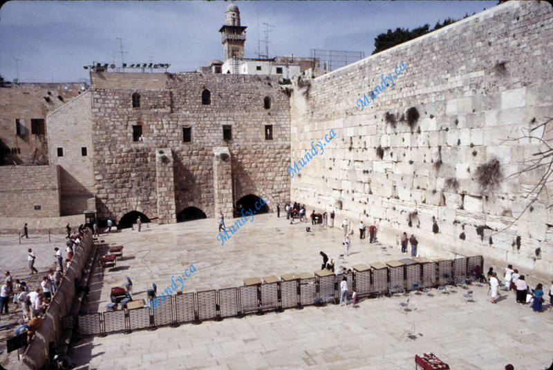 Western Wall.  Fence divides men and women.  The fend on the left keeps people away from the wall until they pass a checkpoint and are given a kippa if they don't have one.  You must wear one to approach the wall ... which I did.  There are many rolled up paper prayers in each of the holes in the walls from people that are removed every night.