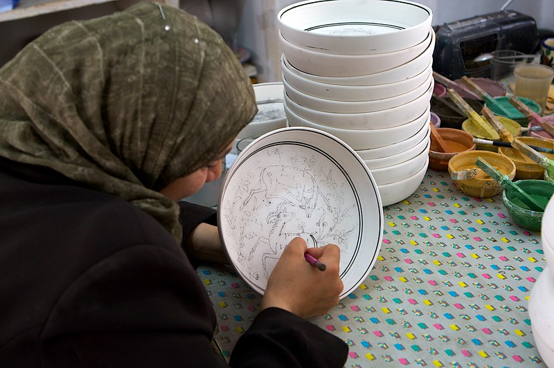 Woman designing Armenian Pottery.