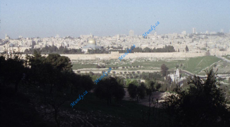 OK, here is the reverse angle.<br /> <br /> Taken from on top of the Mount of Olives in front of the Church of Ascension. Note that directly in front - in an exactly straight line is the Eastern Gate, the Holy of Holies, and the Church of the Holy Sepulcher.<br /> <br /> All 4 of those points happen to be in a straight line.<br /> <br /> Calvary, Holy of Holies, Eastern Gate, and the point of Ascension. <br /> <br /> This may or may not have any significance, but I thought it was interesting. What are the odds of 4 significant points in a city all forming an exactly straight line?<br /> <br /> =================================================================<br /> <br /> I hope you enjoyed seeing these, and that you will have a special time remembering His sacrifice on the cross. It was the single greatest event ever since YHWH *created the universe* and it changed mankind forever. <br /> <br /> A perfect guiltless King left His throne in heaven to be beaten, tortured, and brutally killed ... so that wicked men can become pure enough to exist in the presence of a Holy God. May we never take for granted His sacrifice, and His love.<br /> <br /> [*created the universe*] In 6 days of course.  The first recorderd miracle in scripture.  I do not apologize for the truth in God's word because of a secular worldview that tries to portray the faith in evolution as being science.  That is not only a perversion of science - it is a perversion of the Sword of the Spirit.<br /> <br /> I respect people who are Christians and accept God's Word as truth.  I respect non-Christians who don't believe God's Word is truth.  I do not respect people who call themselves Christians yet attempt to alter scripture to fit their atheistic worldview on creation.  I, like Ravi Zacharias, R.C. Sproul, and others don't believe you can be an authentic Christian and believe in evolution.