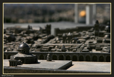 Dome of the Rock model, with the real one shining in the background Jerusalem