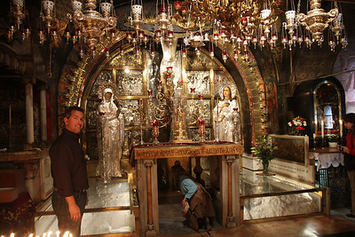 Golgotha - Hard to recognize today but you can see the rock that Jesus was crucified on and the three holes still exist where the roman crosses were stuck into.  They let you place your hand into the hole!