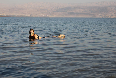 The Dead Sea is known for it's curative mud.  Melanie is trying some now.