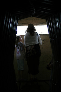 Caitlin and No'am looking out of a bunker used during the Yom Kippur war with Syria.