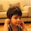 My nephew Berk Kalkancioğlu. Clever and NAUGHTY!! boy, listening to Jazz on my iPhone:  'Highway Blues' - Marc Seales
