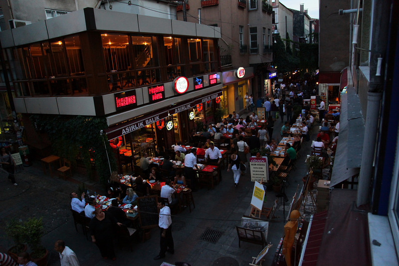 Hanging out of the window of my hairdresser in Kadıköy.<br /> Streets are crammed with tables. <br /> Please visit the famous CIYA restaurant, and you will taste something that you have never tasted before...