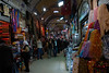 """The Grand Bazaar (or Covered Bazaar, Kapalıçarşı in Turkish) in Istanbul (at 41°0′38.09″N, 28°58′4.56″E) is one of the largest covered markets in the world with more than 58 streets and 4,000 shops, and has between 250,000 and 400,000 visitors daily. It is well known for its jewelry, pottery, spice, and carpet shops. Many of the stalls in the bazaar are grouped by type of goods, with special areas for leather coats, gold jewelry and the like. The bazaar contains two bedestans, or domed masonry structures built for storage and safe keeping, the first of which was constructed between 1455 and 1461 by the order of Sultan Mehmed the Conqueror. The bazaar was vastly enlarged in the 16th century, during the reign of Sultan Suleiman the Magnificent, and in 1894 underwent a major restoration following an earthquake.<br /> <br /> Technically, the correct translation of the Turkish name Kapalıçarşı is """"Covered Bazaar"""" and not """"Grand Bazaar"""", simply because the Turks do not call it """"Grand Bazaar"""". In Turkish kapalı means """"covered"""" and çarşı means """"market"""" or """"bazaar"""" (as in the Persian 'bazar', where the word originates from and in English spelled """"bazaar"""".)"""