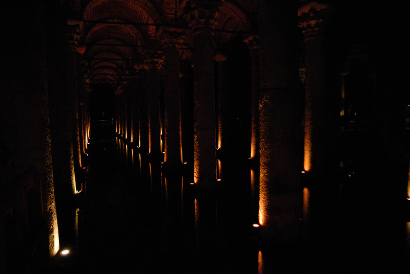 The Basilica Cistern, also called the Yerebatan Sarayı or Yerebatan Sarnıcı, is the largest of several hundred ancient cisterns that still lie beneath the city of Istanbul, former Constantinople, Turkey.<br /> <br /> This cathedral-sized cistern is an underground chamber of 143 by 65 metres, capable of holding 80,000 cubic metres of water. The large space is broken up by a forest of 336 marble columns each 9 metres high. The bases of two of these columns reuse earlier blocks carved with the head of a Medusa.<br /> <br /> The cistern, located in the historical peninsula of Istanbul, was built by the Greeks during the reign of emperor Justinian I in the 6th century, the age of glory of Eastern Rome, also called the Byzantine Empire. The cistern is surrounded by a firebrick wall with a thickness of 4 meters and coated with a special mortar for insulation against water. The cistern's water was provided from the Belgrade Woods—which lie 19km north of the city—via aqueducts built by the emperor Justinian.<br /> <br /> The cistern was used as a location for the James Bond film From Russia with Love. It is a popular tourist attraction.