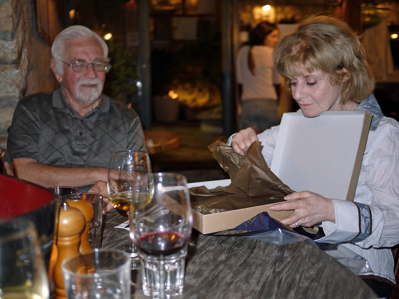 After returning from Bethlehem, we went to dinner with Angie and Mel's Israeli friends.  Here, Angie is opening a gift from them.