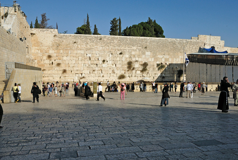 The Western (Wailing) Wall is the section of the supporting wall of the Temple Mount which has remained intact since the destruction of the Second Jerusalem Temple  in 70 C.E. by the Romans.   It became the most sacred spot in Jewish religious and national consciousness and tradition by virtue of its proximity to the Western Wall of the Holy of Holies in the Temple, from which it is believed the Divine Presence never departed. It became a center of mourning over the destruction of the Temple and Israel's exile, and in the 20th century of religious national communion with the memory of Israel's former glory and the hope for its restoration.