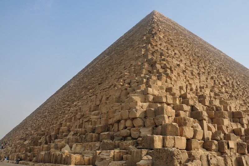 The Great Pyramid.  This is the oldest and largest of the three pyramids on the Giza Plateau.  It's also the oldest of the Seven Wonders of the Ancient World and the only one that survives substantially intact. The pyramid was built as a tomb for fourth dynasty Egyptian Pharaoh Khufu (Cheops in Greek) and constructed over a 20 year period concluding around 2551 BC. The Great Pyramid was the tallest man-made structure in the world for over 3,800 years. Originally the Great Pyramid was covered by casing stones that formed a smooth outer surface, but what's seen today is only the underlying core structure.