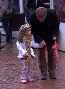 Isn't this little girl adorable? Ted loved the scarf and cap and hair.