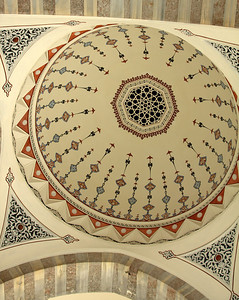 painted dome combined with stone detail on the arches