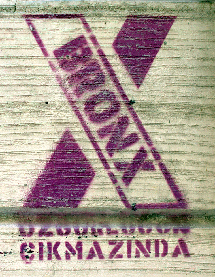 Graffiti stencil advertising.