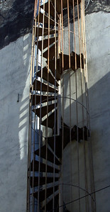 Spiral staircase. Commonly retrofitted emergency exit.