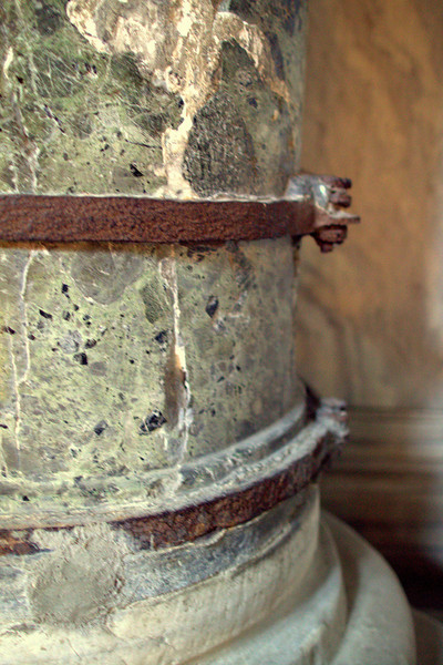 Old iron straps to hold a column together.